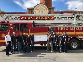 Las Vegas Fire and Rescue Group picture in front of fire truck