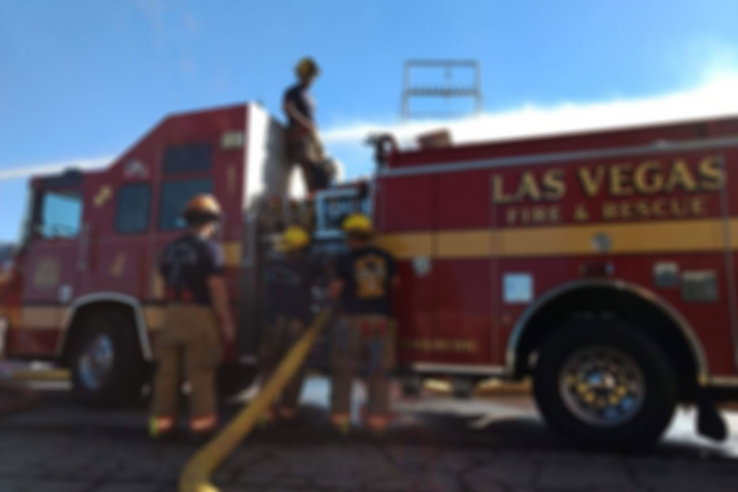 Las Vegas Fire truck with firemen working background for slider